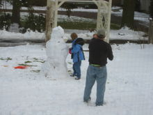 Uncle Bob and Chrislyn, fixing the snowman.