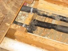 Second floor bathroom, piping in floor.